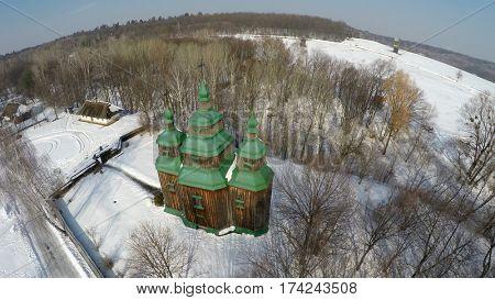 Traditional Ukrainian church in winter, Pirogovo, aerial view