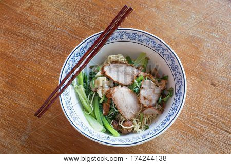 Thai noodle pok pok with chopsticks on wooden table