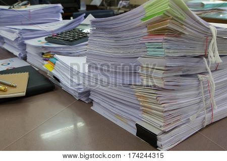 Business Concept Pile of unfinished documents on office desk Stack of business paper