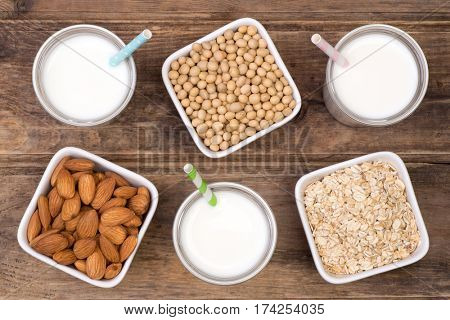 Milk alternatives, almond, soy and oat, top view