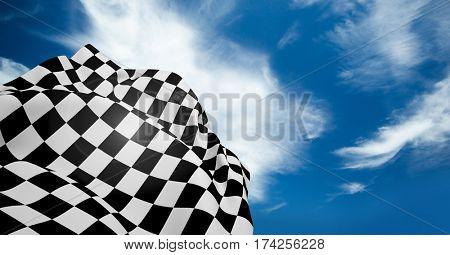 Digital composite of checkered flag waving against cloudy sky