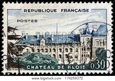 LUGA RUSSIA - FEBRUARY 7 2017: A stamp printed by FRANCE shows view of The Royal Chateau de Blois located in Loir-et-Cher department in Loire Valley in France in the city of Blois circa 1960