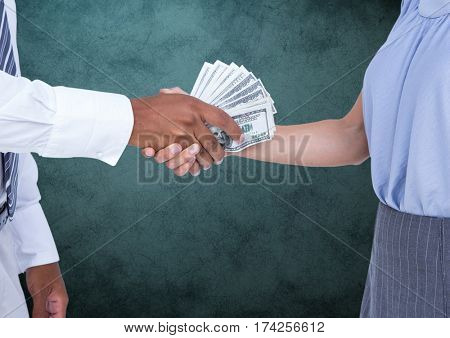 Digital composite image of businessman bribing partner while shaking hands against teal background