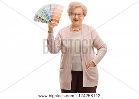 Mature woman holding a color swatch isolated on white background