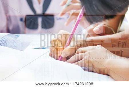 students writing test exam on paper for Admissions in high school with uniform student in School classroom of Thailand exam student background and education concept double exposure tone