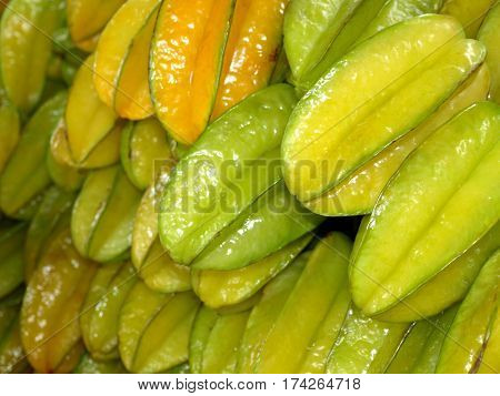 Star fruit or Carambola for sale at the market. Fresh and sweet tropical fruit. Healthy fruit.