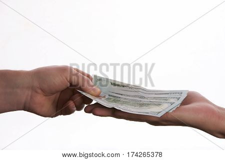 Close-up Of Person Hand Giving US dollar banknote money. Сoncept of salary.