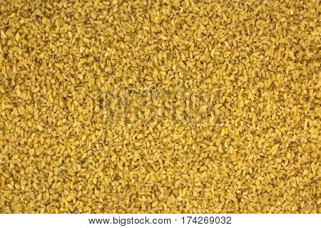 background of dry bulgur wheat from above