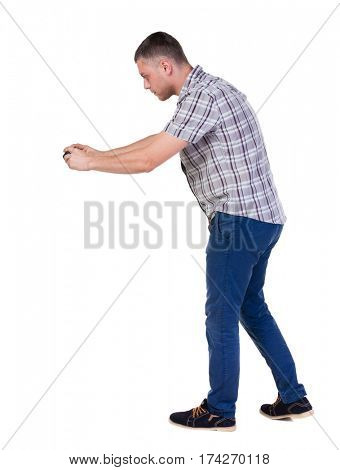 Back view of man photographing. tourist with camera. Rear view people collection.  backside view of person.  Isolated over white background.