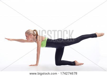 Workout till you sweat. Shot of an attractive young fitness woman exercising doing butt and thigh workout isolated on white copyspace above
