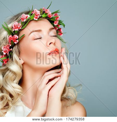 Relaxing Spa Model Blonde Woman with Healty Clean Skin and Flowers. Antiaging and Cosmetology