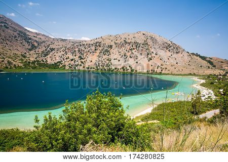 Beach in village Kavros in Crete island Greece. Magical turquoise waters lagoons. Travel Background