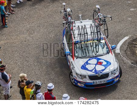 Col de PailheresFrance- July 06 2013: Technical car of Lotto Belisol procycling team climbing the road to Col de Pailheres in Pyrenees Mountains during the stage 8 of the 100 edition of Le Tour de France on 6 July 2013.