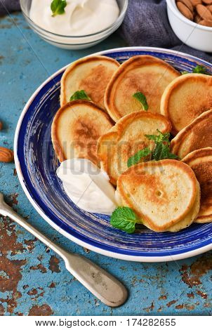 Homemade pancakes with sour cream and honey for breakfast