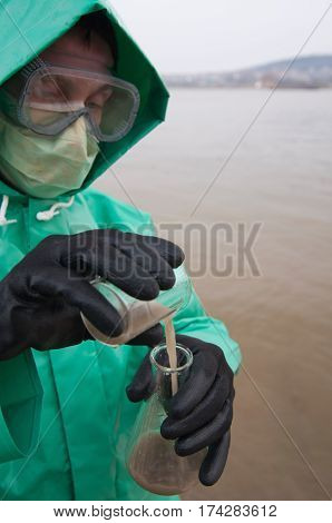 Environmentalist Examining River Water