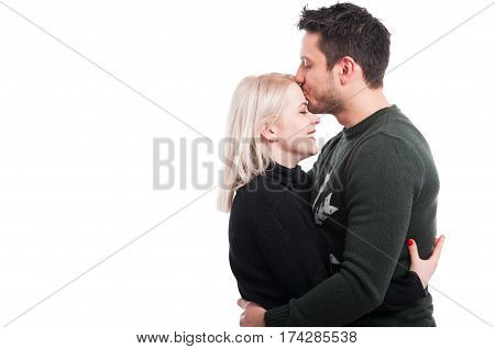 Handsome Male Kissing His Girlfiend On Forehead