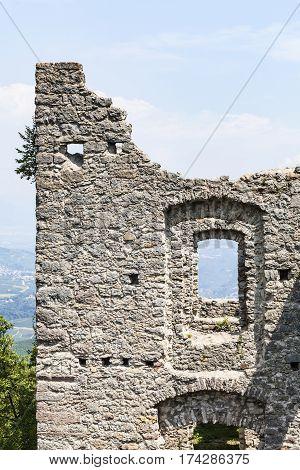 View through windows of ruin Castel Belfort near Spormaggiore in Trento in Italy Europe