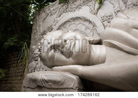Lying sleeping Buddha on the lotus in Long Son Pagoda, Nha Trang, Vetnam. The face of Buddha o the road to nirvana