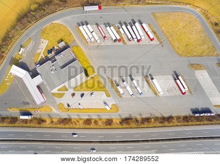 Aerial view of parking lot with trucks. Industrial background on transportation theme.