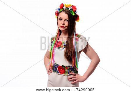 Girl In Ukrainian National Traditional Costume Holding Her Flower Chaplet - Isolated On White