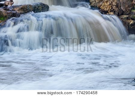 Water cascading between some rocks at a waterfall