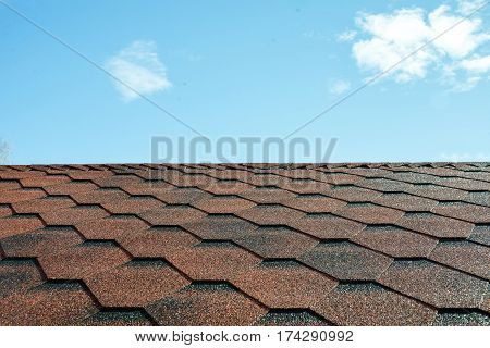 Tile roofs, patterns of the blue sky