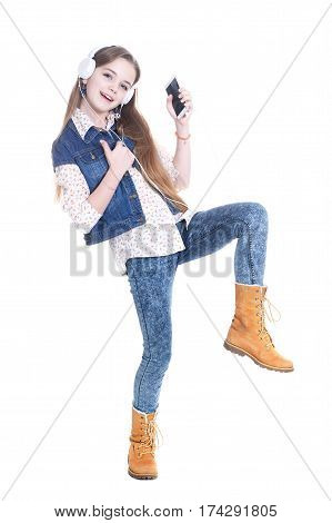 Portrait of a teen girl with phone and headphones