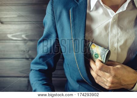 Businessman, Member Or Officer Puts A Bribe In His Pocket