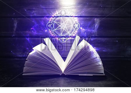 Book On The Table Out Comes Light And Magic Sign