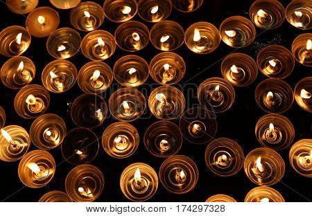 Candles Lit With The Warm Flame During The Religious Rite