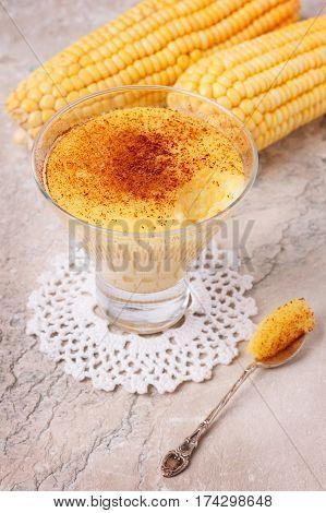 Brazilian sweet custard-like dessert curau de milho mousse of corn with cinnamon. Selective focus poster