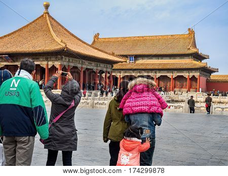 Beijing, China - Oct 30, 2016: Visitors walking toward the Hall of Central Harmony (front) and the Hall of Preserved Harmony (back). Forbidden City (Gu Gong, Palace Museum).