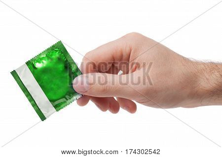 Condom in male hand isolated on white background