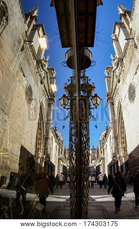 Reflection Of The Street Next To The Cathedral Of Toledo In The Window, Castilla La Mancha, Spain