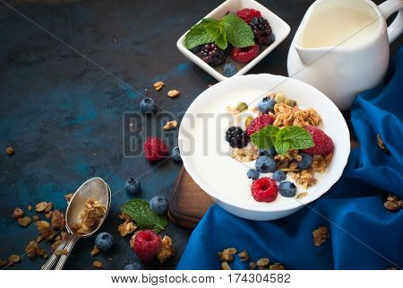Healthy breakfast. Greek yogurt with granola and fresh berries. Top view with copy space.