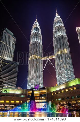 Kuala Lumpur, Malaysia - January 2, 2017: View of the Petronas Twin Towers and a fountain underneath. They are the tallest twin towers in the world.