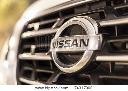 ABU DHABI UAE - NOV 26 2016: Nissan company logo on a car illuminated at night