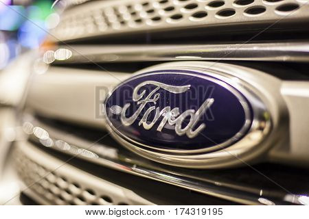 ABU DHABI UAE - NOV 26 2016: Ford company logo on a car illuminated at night