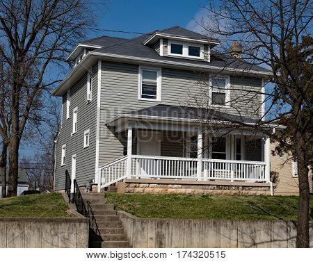Gray American Foursquare House on Hill