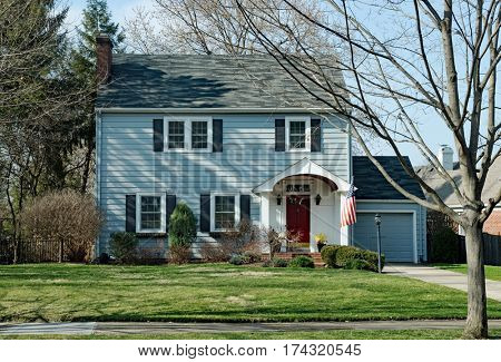Blue Two Story House with American Flag