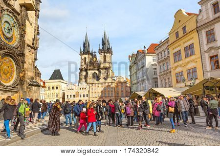 Prague, Czech Republic - February 25, 2017: People at Old Town Square, Stare Mesto in front of Tyn Church and famous Astronomical Clock