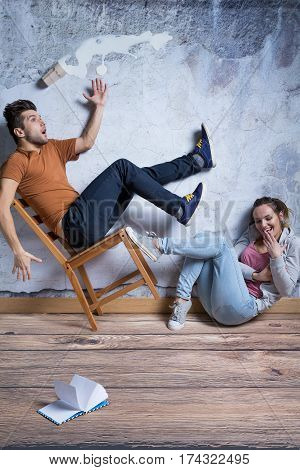 Man On Toppling Chair