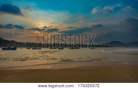 A coastline scene at sunset looking out over the south China sea in Vung Lam Bay Vietnam.