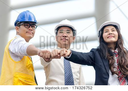 Group Of Architects Team Touching Hands Together. Selective Focus.