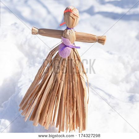 Traditional handmade straw doll gift on the Shrovetide carnival