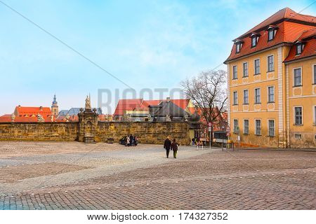 Bamberg, Germany - February 19, 2017: Bamberg city center view with statue, cathedral square and people