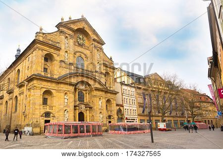 Bamberg, Germany - February 19, 2017: Bamberg city center street view with cathedral and people