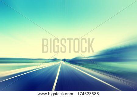 Empty asphalt road in motion blur. Vintage style.