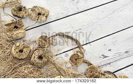 Fishing net or nautical vessel on wooden planks. Beach background or summer background with copy space.