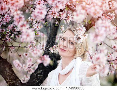 Beautiful young woman in a beautiful flowering gardens